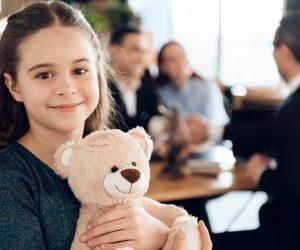 kid hugging a teddy bear