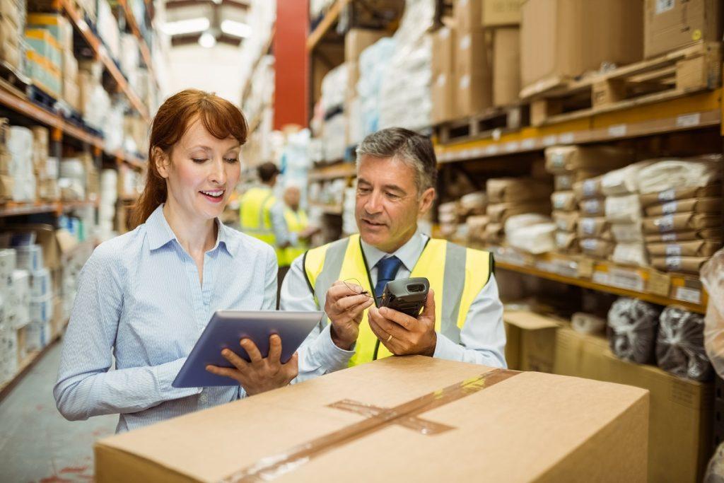 man and woman at a warehouse