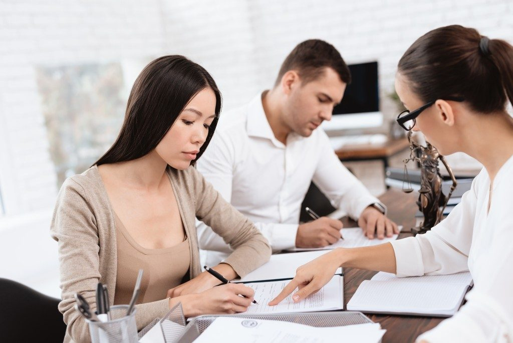 female divorce mediator showing couple where to sign