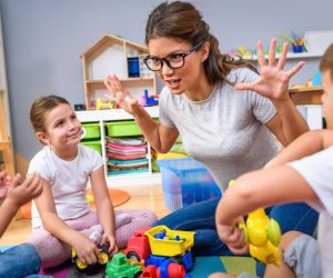 teacher playing with kids