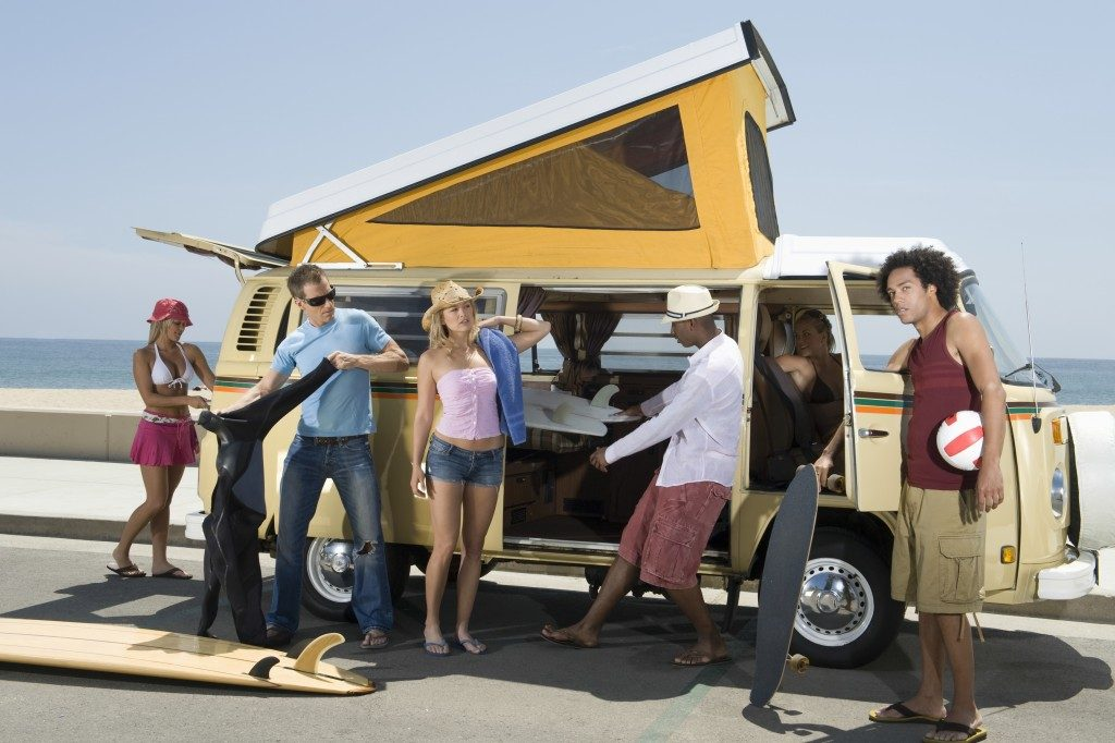 Group of young people by campervan