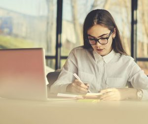 businesswomen writing in her notebook