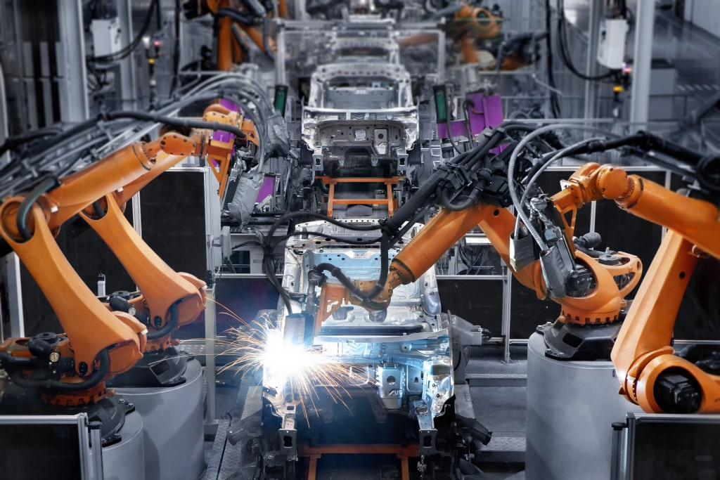 Robotic arms used in a car manufacturing factory