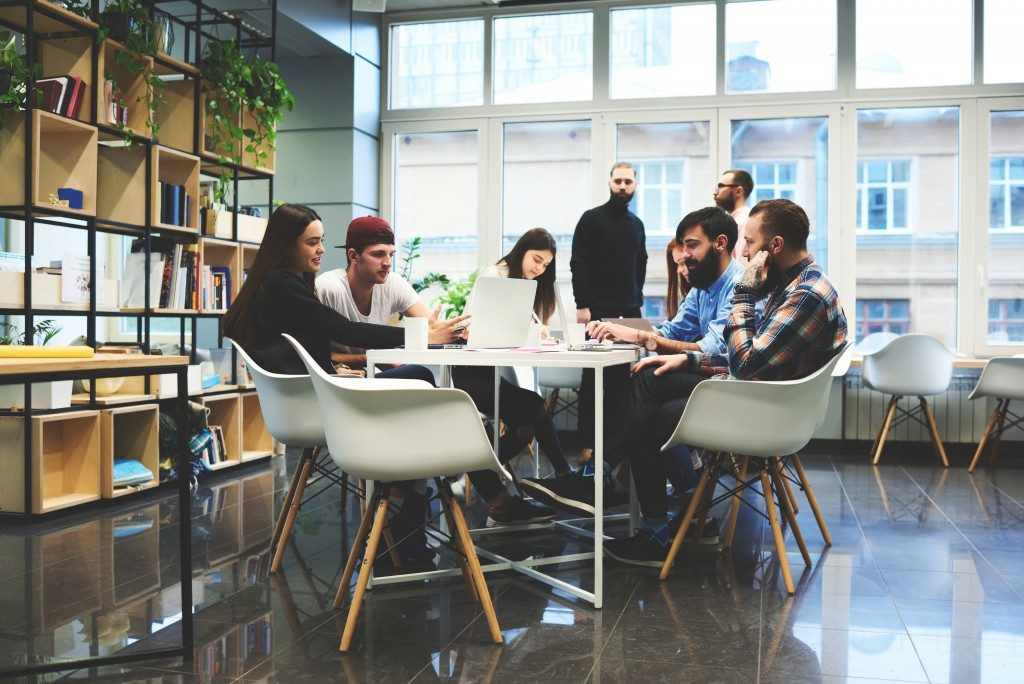 Group of casually dressed businesspeople in coworking space