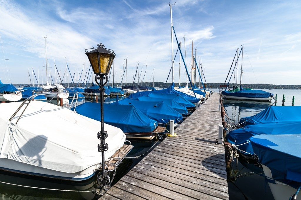 Yachts at wooden pier