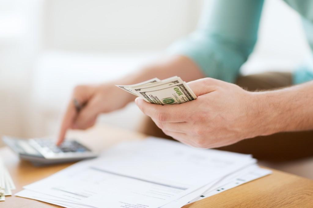 man computing utility expenses