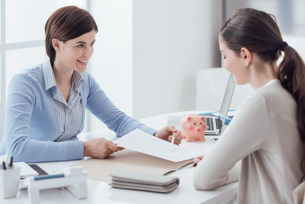 woman handing a contract to the debtor