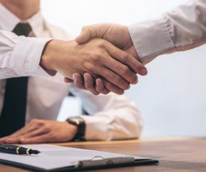 Client and agent handshake insurance agreement