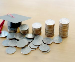 coins and small graduation cap