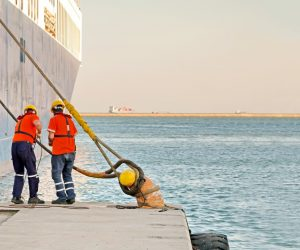 Seafarers tying ropes