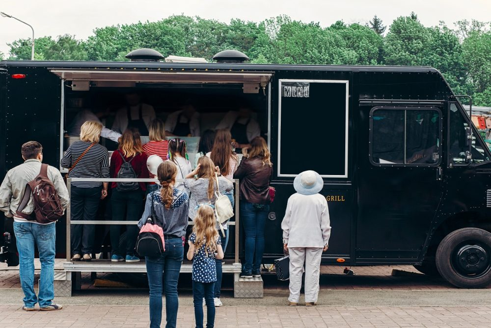 People flocking in a food truck