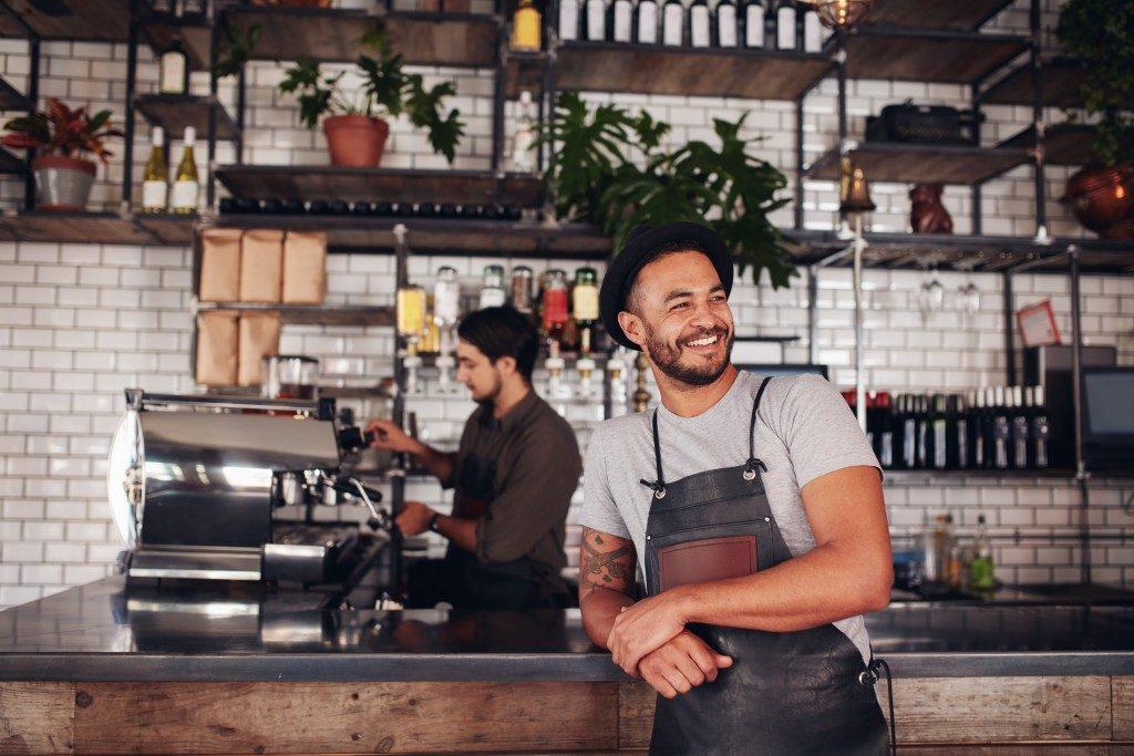 Cafe owner posing
