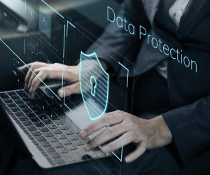 data protection hologram over working employee