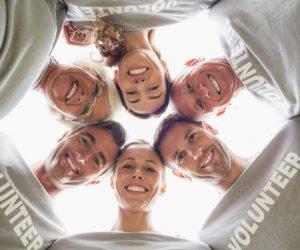 Group of volunteers huddled together