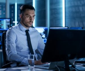 cybersecurity concept, employee working in his desktop and laptop