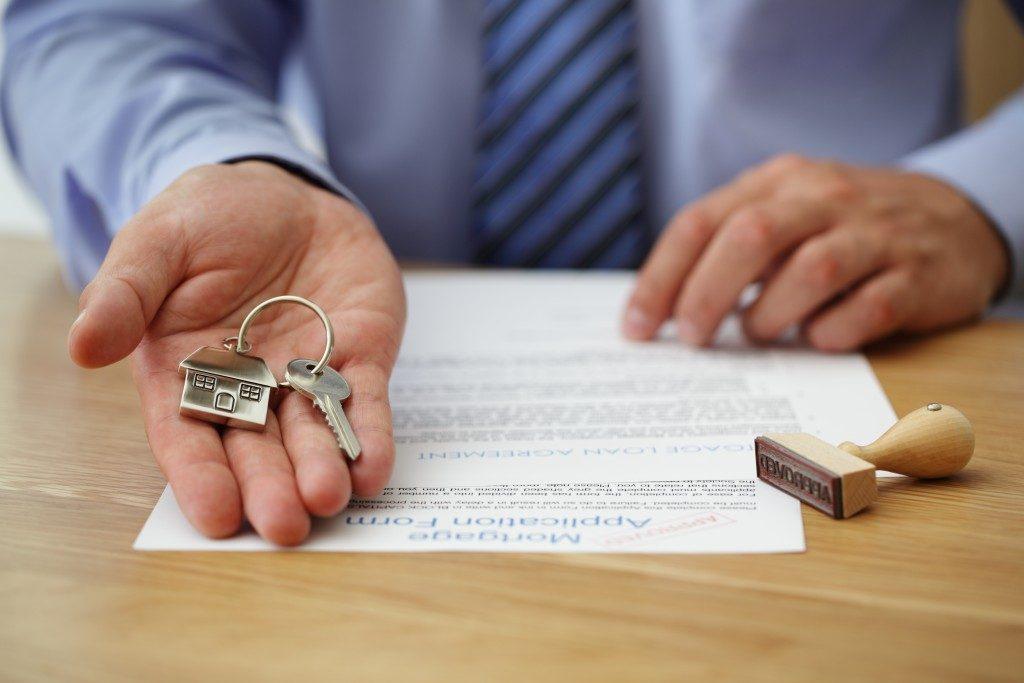 Man handing house keys