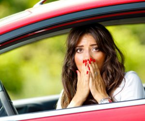 worried woman in her car