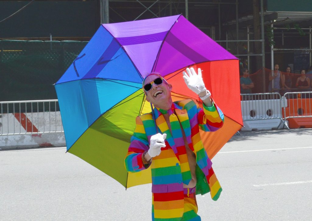 man wearing a rainbow suit