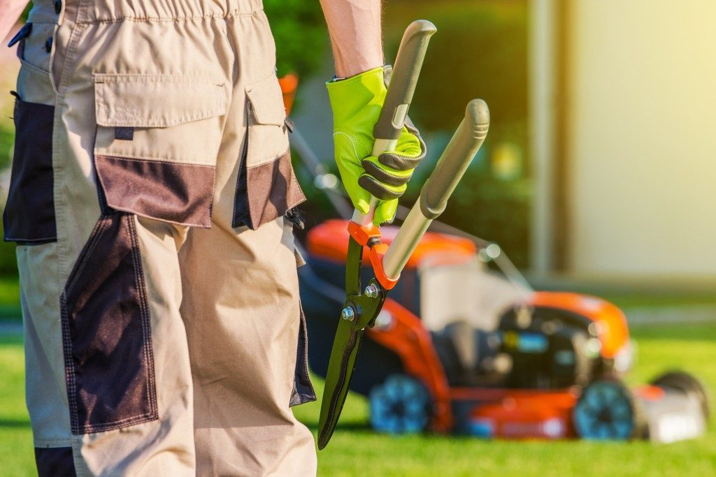 landscaper with equipment