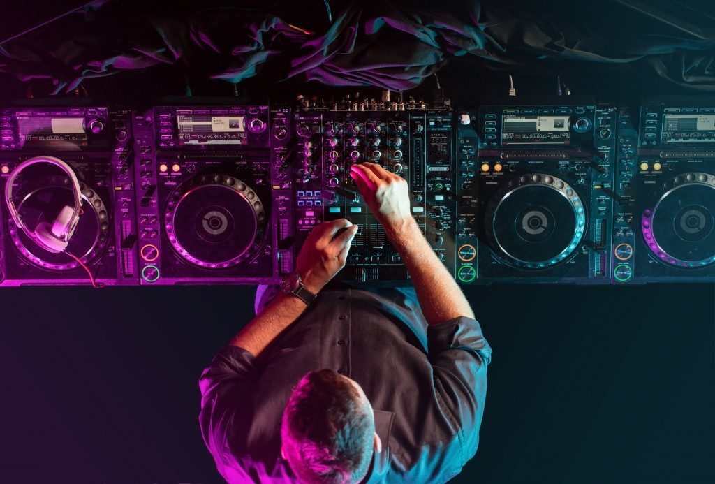 Charismatic disc jockey at the turntable