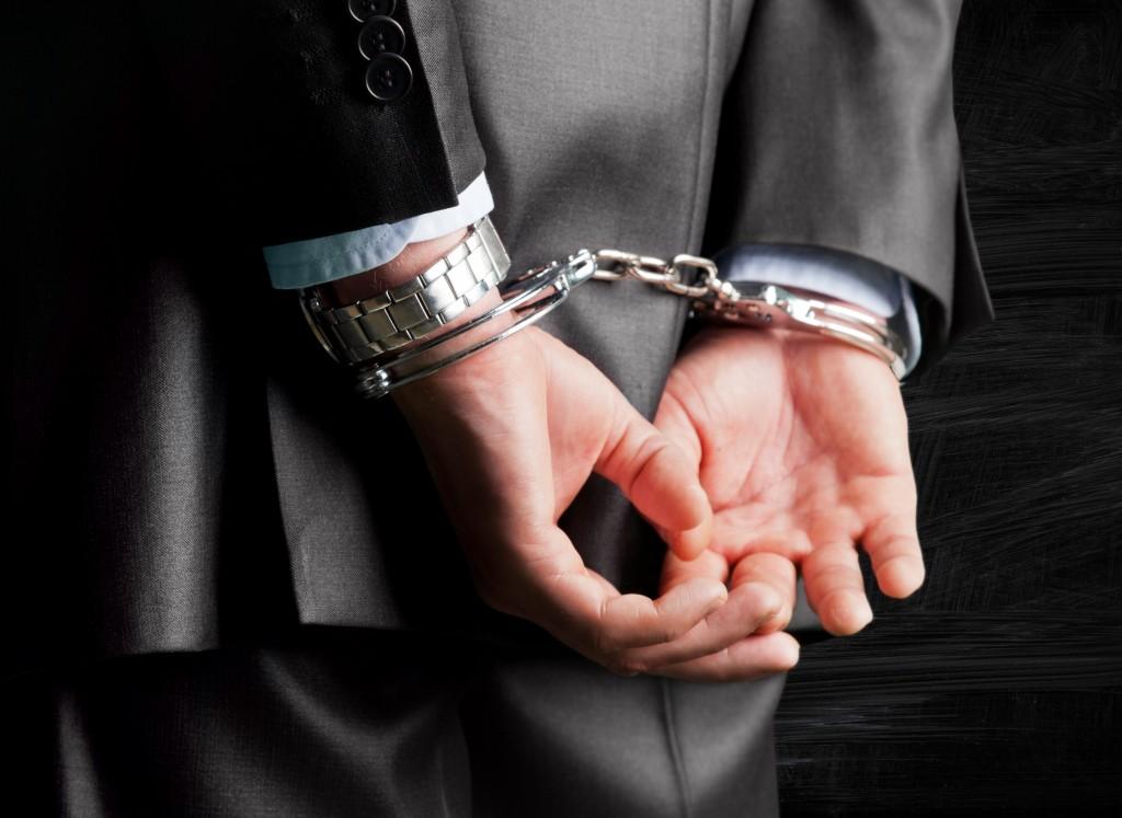 handcuffs on a man