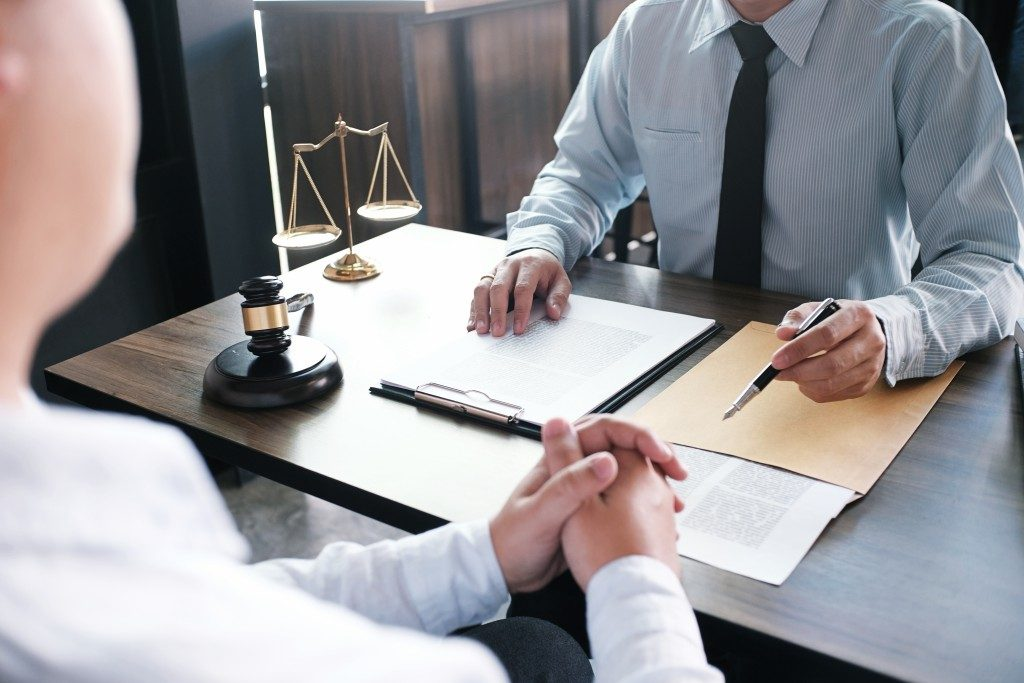 client consulting a lawyer