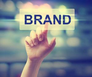 hand pushing brand button