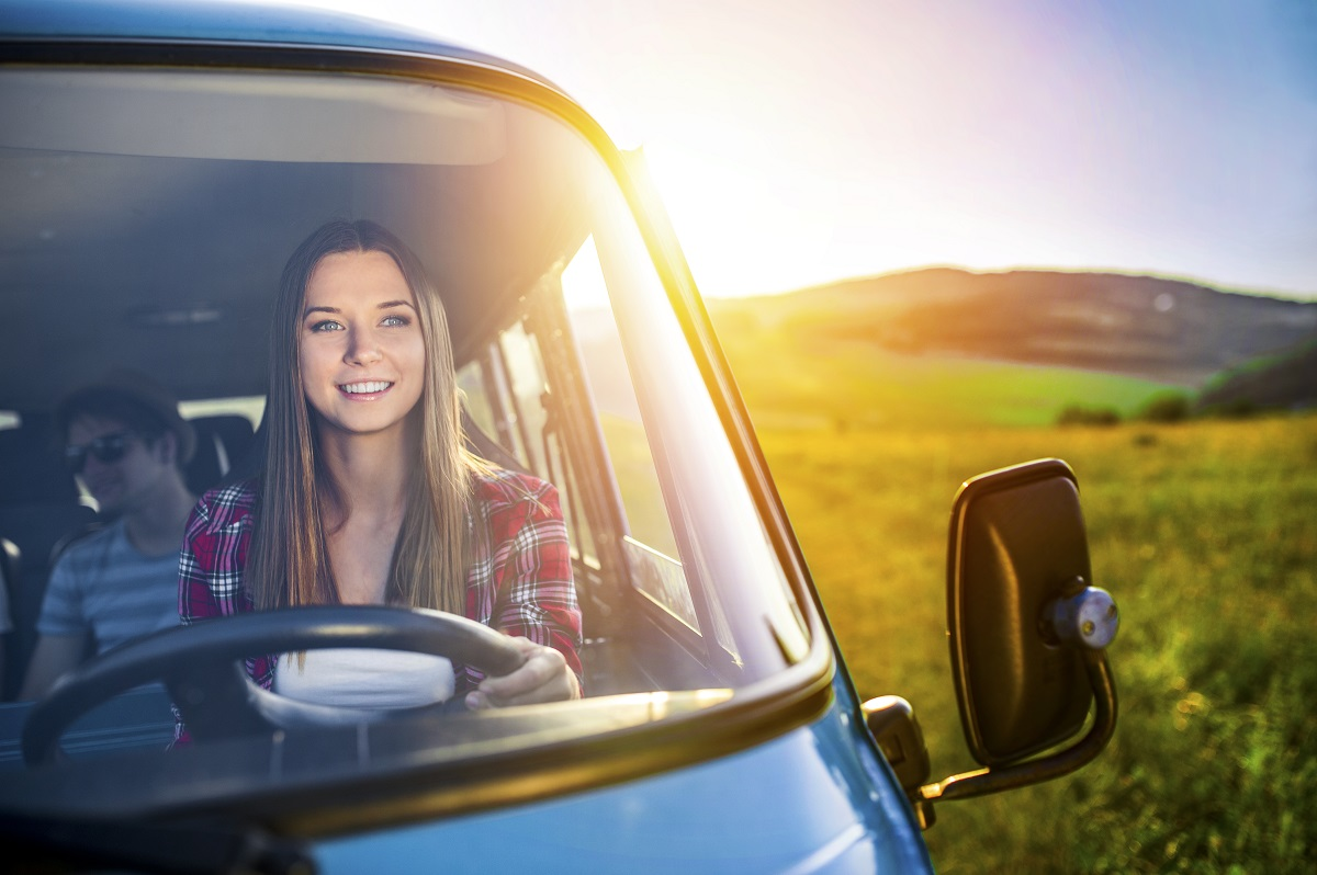 woman driving with friends