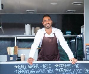 man in his food truck business
