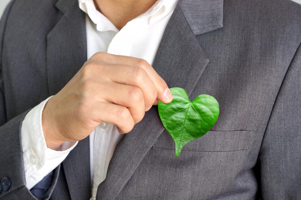 heart shaped leaf on businessman's pocket