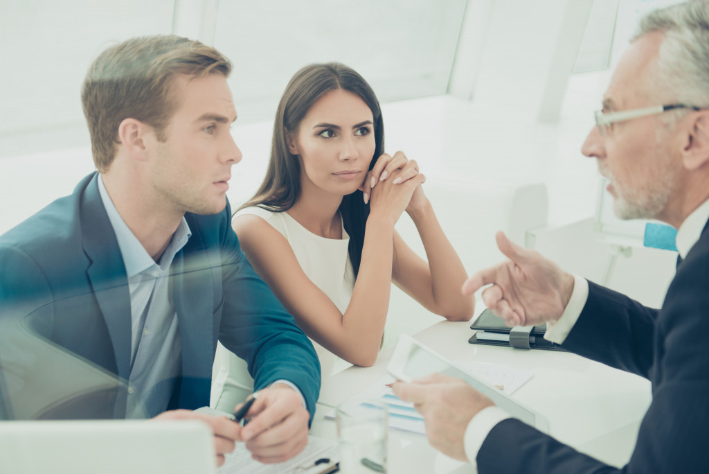 people consulting a lawyer
